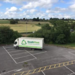 View of a liveried lorry in an empty car park from above