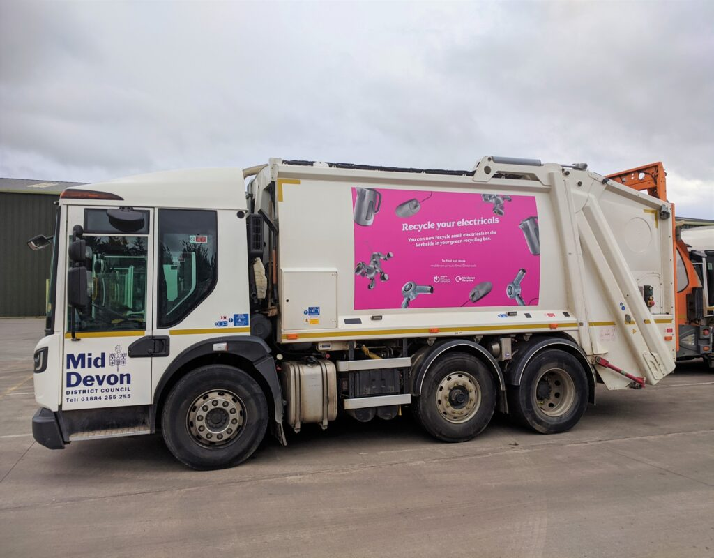 Local authority kerbside refuse vehicle with electrical & electronic recycling advertisement